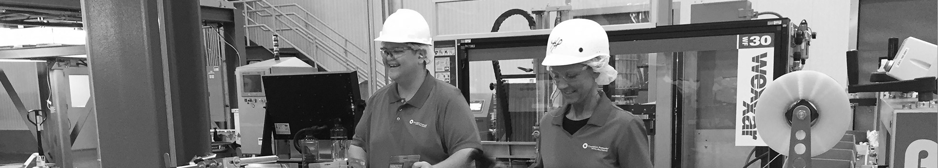 Walter and Kim on the packaging line, DogStar Kitchens